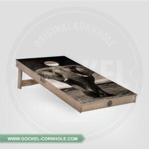 Cornhole board with elephant print.