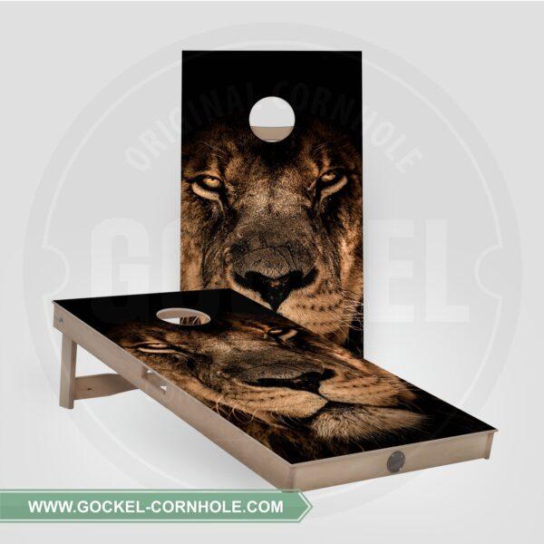 Cornhole boards with a lion print.