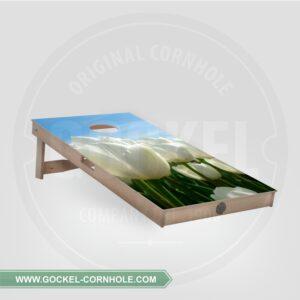 Cornhole board with tulips print.